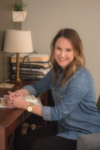 Picture of Laura Jordan smiling while sitting down at desk in office while wearing blue jean shirt. If you're looking for an empathetic therapist in indiana or texas, you've found yours! Jordan Therapy Service offers postpartum depression services and online therapy. Are you curious about message-based therapy at Jordan Therapy? Email today to find out more.