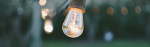 Light bulb up close with lights in the background blurred and lit up. If you're looking for help with mental health, jordan therapy services could be the place for you. Contact Laura Jordan Today!