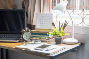 Computer on desk with calander, clock, plants and headphones. If you're ready to begin counseling Laura Jordan is here to work with you. Online therapy makes counseling more accessible and comfortable. If you're ready to begin online emdr therapy in texas or online therapy in indiana, get in touch today!