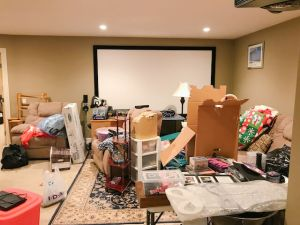 This cluttered basement makes it impossible for the family to relax