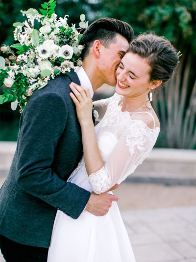 Stylish Texas couple with white anemone and green bouquet. Florist Jessica Ormond Events. Fine Art Photographer Katie Rivera.
