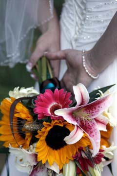 Sunflower, pink Gerbera Daisy, Stargazer Lily, and Wheat bridal bouquet // Design: Jessica Ormond Events. Lubbock Texas boutique wedding florist.