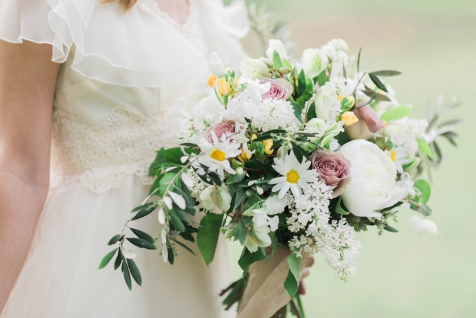 Wild, boho bouquet with peonies, roses, and lilacs. Flowers and styling Jessica Ormond Events. Photography Emily Koontz.