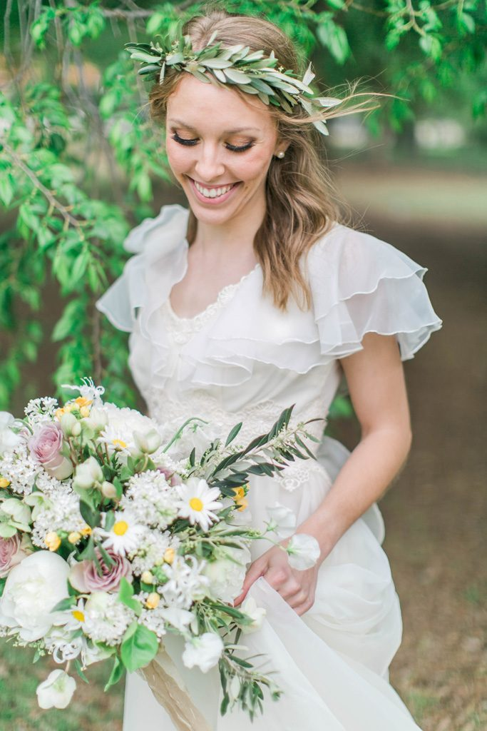 Joyous bride with a wild and romantic bouquet. Flowers and styling Jessica Ormond Events. Photography Emily Koontz.