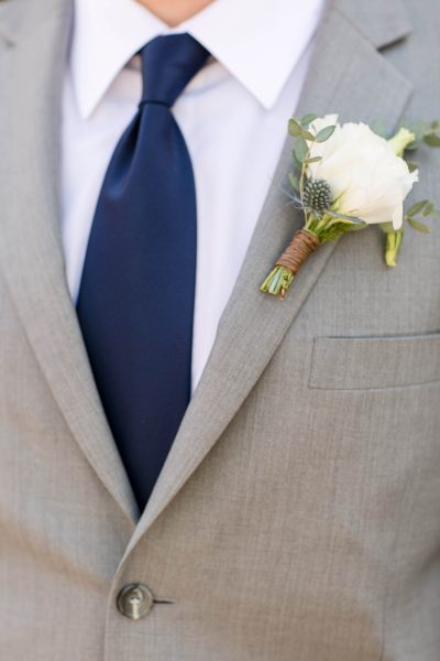 Thistle and white rose boutonniere. Design by Jessica Ormond Events. Photo by Allee J Photography.