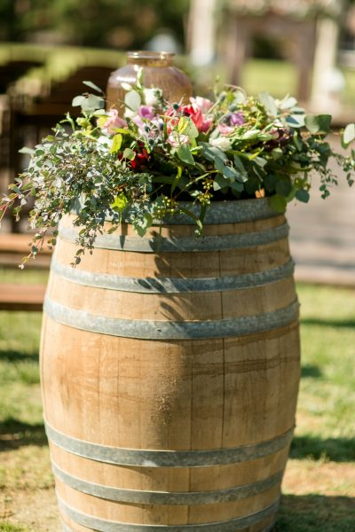 Wine barrel with lantern and greenery for rustic chic wedding ceremony. Flowers and Planning by Jessica Ormond Events. Photo by Allee J Photography.