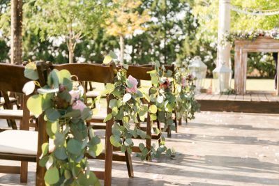 Rustic silver dollar eucalyptus aisle ends at an outdoor west Texas wedding. Flowers and Planning by Jessica Ormond Events. Photo by Allee J Photography.