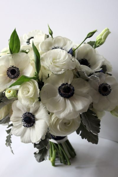 Elegant spring bridal bouquet of Anenomes and Ranunculus for Lubbock wedding at the Texas Tech Club. Designed by Jessica Ormond Events.