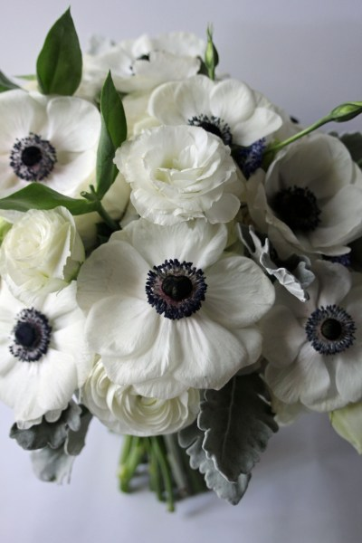 Anenome with heart center in elegant white bouquet designed by Jessica Ormond Events for March wedding at the Texas Tech Club