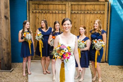 Gold and Navy wedding of colorful spring flowers at McPherson's