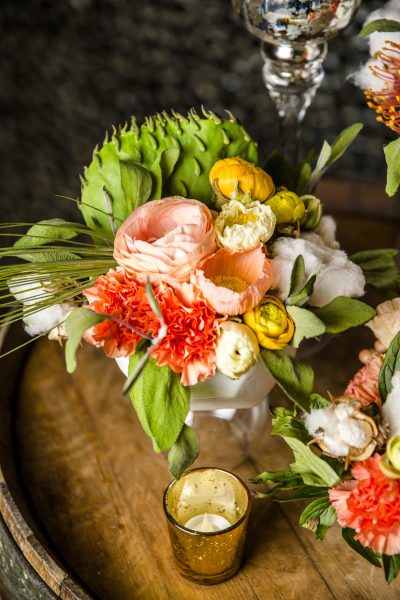 Cactus, Poppy, Cotton, and Ranunculus ceremony flowers arranged by Jessica Ormond Events. Photo by Caitlin & Ryan Photography.