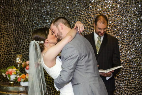 First Kiss Southwest Winery Wedding in Lubbock. Caitlin & Ryan Photography.