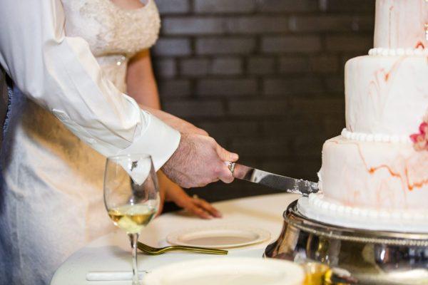 Cake cutting at McPherson's Cellars wedding reception. Texas wedding planner Jessica Ormond Events. Caitlin & Ryan Photography.