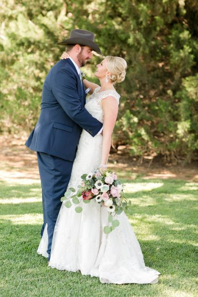 Bride and Groom at Cotton Creek Barn New Home Texas. Lubbock wedding planner Jessica Ormond Events. Photo by Allee J Photography.