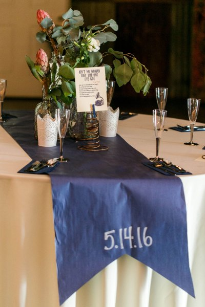 Blue craft paper table runners and wedding reception details