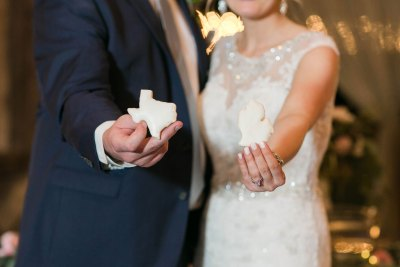 Bride and Groom with Texas and Michigan state sugar cookies. Jessica Ormond Events wedding planner. Allee J Photo.