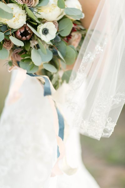 Bridal bouquet with silk ribbon and veil. Photo by Allee J. Flowers by Jessica Ormond Events.