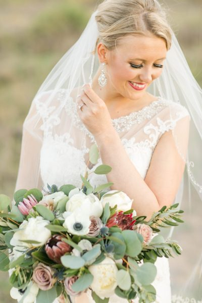 Stunning bride photographed by Allee J with lush bouquet designed by Lubbock wedding florist Jessica Ormond Events.