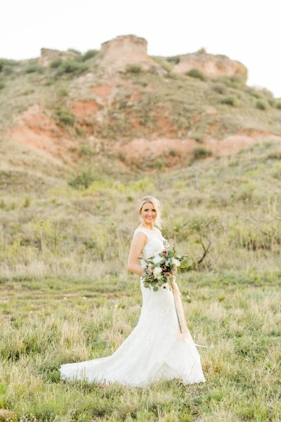 Elegant bride in canyon photographed by Texas photographer Allee J. Bouquet created by Jessica Ormond Events.