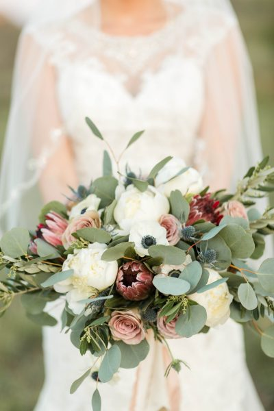 Lush and textured bridal bouquet of Protea, Anenome, and Peony created by Jessica Ormond Events in Lubbock Texas. Photographed by Allee J.