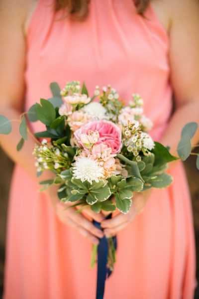 Coral and white garden style bridesmaid bouquet of Garden Rose, Stock, and Scabious designed by Lubbock wedding florist Jessica Ormond Events. Picture by Amanda Scott Photograhy.