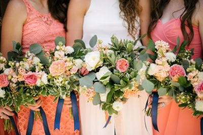Garden style bouquets of Garden Roses, Ranunculus, Scabious, Stock designed by Lubbock wedding florist Jessica Ormond Events. Picture by Amanda Scott Photograhy.
