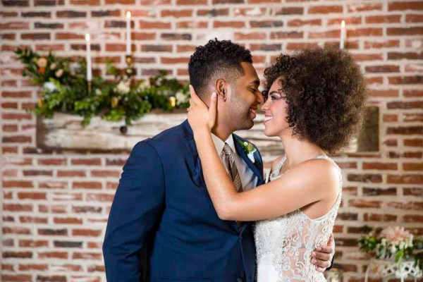 Bride and groom with fireplace back drop. Eberley Brooks style shoot. Wedding planner Jessica Ormond Events. West Texas photographer Caitlin and Ryan Photography.