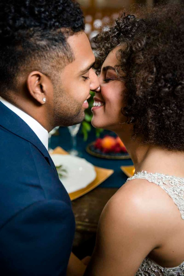Eberley Brooks bride and groom kissing at the sweetheart table. Lubbock Texas wedding planner Jessica Ormond Events. Caitlin and Ryan Photography.