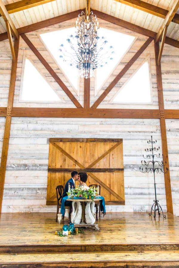 Bride and groom at the sweetheart table at the stunning Eberley Brooks Events in Texas. West Texas wedding planner Jessica Ormond Events. Caitlin and Ryan Photography.