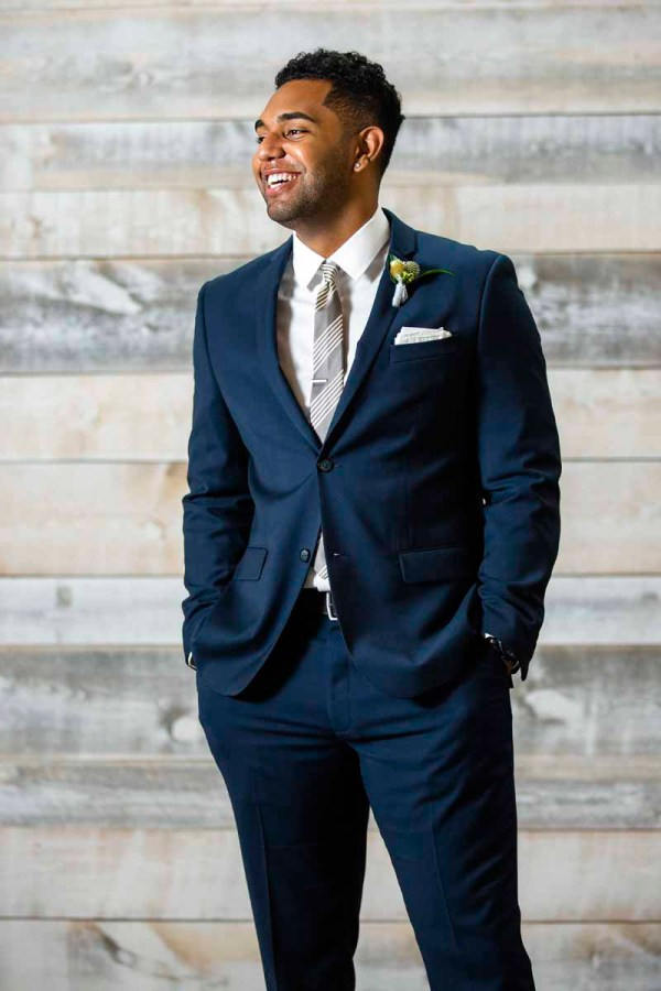 Dapper groom in navy suit for Texas style shoot at Eberley Brooks Events. Featuring wedding planner Jessica Ormond Events. Caitlin and Ryan Photography.