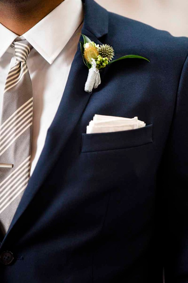 Boutonniere of thistle and billy ball designed by Jessica Ormond Events. Caitlin and Ryan Photography.