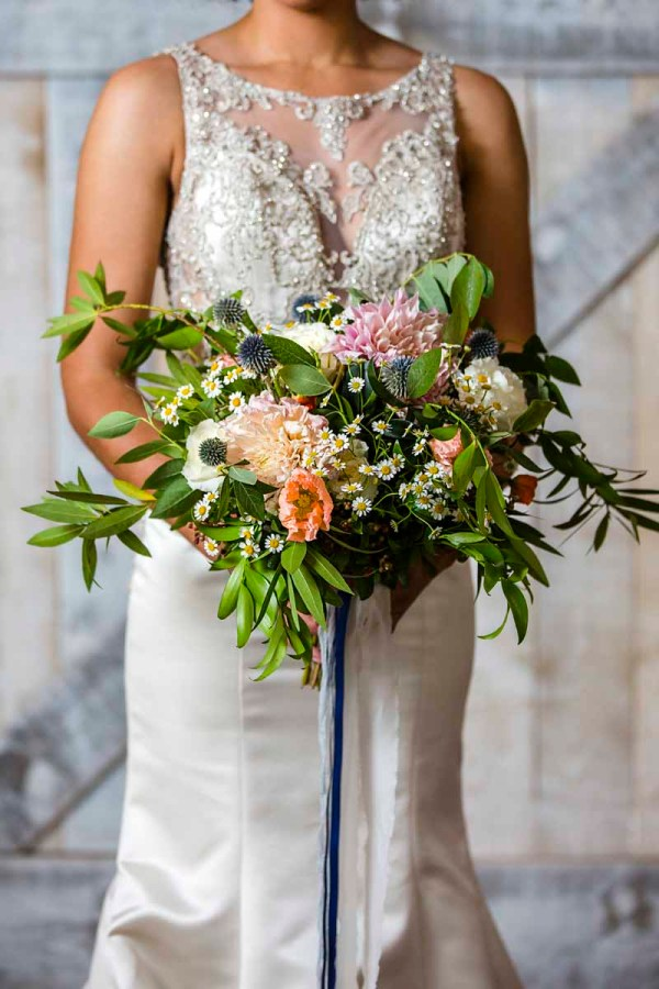 Wild English garden bouquet of cafe latte dahlia, poppies, thistles, chamomile with blue silk ribbon designed by wedding florist Jessica Ormond Events for West Texas style shoot by Caitlin and Ryan Photography.