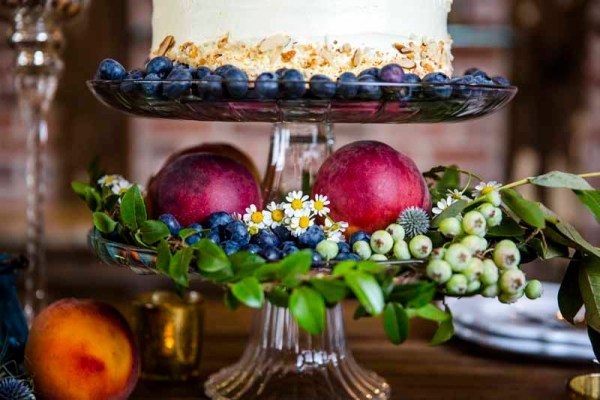 Cake with peaches and blueberries on the bar at Eberley Brooks Events. Lubbock Wedding Planner Jessica Ormond Events. Photography by Caitlin and Ryan Photography.
