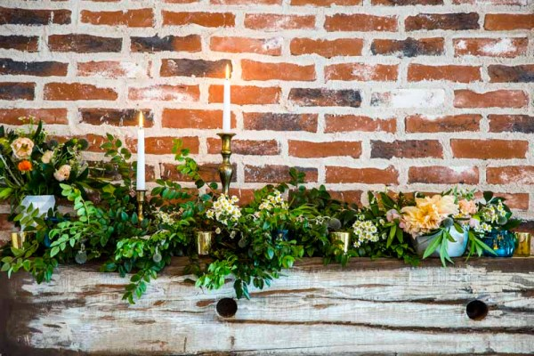 Close up of wild greens and candles on Eberley Brook's fireplace mantel. Lubbock Texas. Designed by Jessica Ormond Events. Caitlin and Ryan Photography.