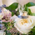 Rings on bridal bouquet of hydrangea, garden rose, rice flower, and lavender. Bouquet designed by Jessica Ormond Events. Photo by Linda McMillan Photography.