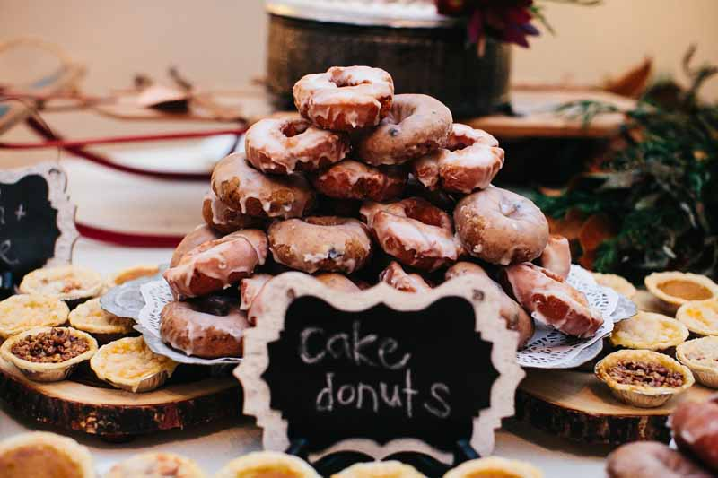 Donuts on the dessert buffet at a brunch wedding reception. Historic Downtown wedding. Photo by Betsy. Jessica Ormond Events styling and planning.