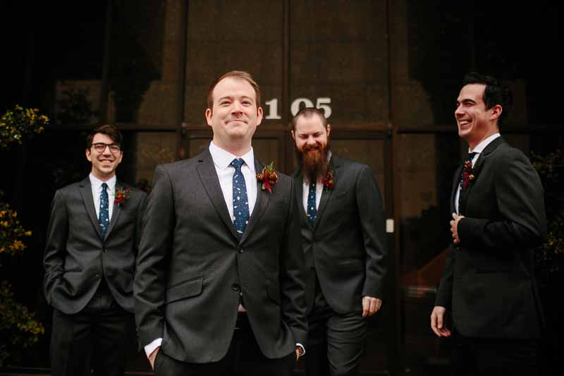 Groom and groomsmen at Watson Building. Texas wedding photographer Photo by Betsy. Wedding planner Jessica Ormond Events.