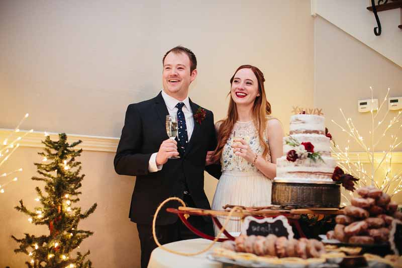 Bride and Groom listening to toasts at their Lubbock winter wedding. Photo by Betsy. Jessica Ormond Events wedding planner.