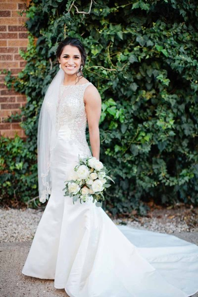 Bridal portraits at Legacy Event Center in Lubbock Texas. Bride in glamours trumpet gown with white bouquet. Texas wedding florist Jessica Ormond Events. Lubbock photographer Tara Hobgood Photography.