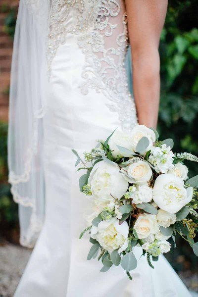 White peony and rose wedding bouquet designed by florist Jessica Ormond Events. Image by Texas wedding photographer Tara Hobgood Photography.