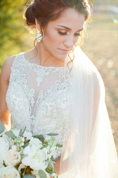 Elegant bride at sunset in Lubbock, Texas. Bouquet designed by florist Jessica Ormond Events. Image by Tara Hobgood Photography.