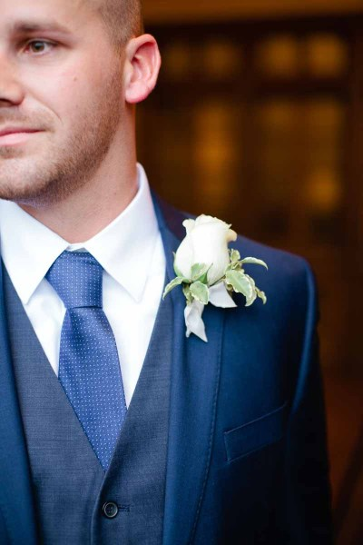 Elegant white rose boutonniere for a winter Texas wedding. Designed by Lubbock florist Jessica Ormond Events. Tara Hobgood Photographer.