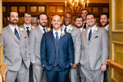 Groom and groomsmen with classic white rose boutonnieres designed by Lubbock wedding florist Jessica Ormond Events. Tara Hobgood Photography.