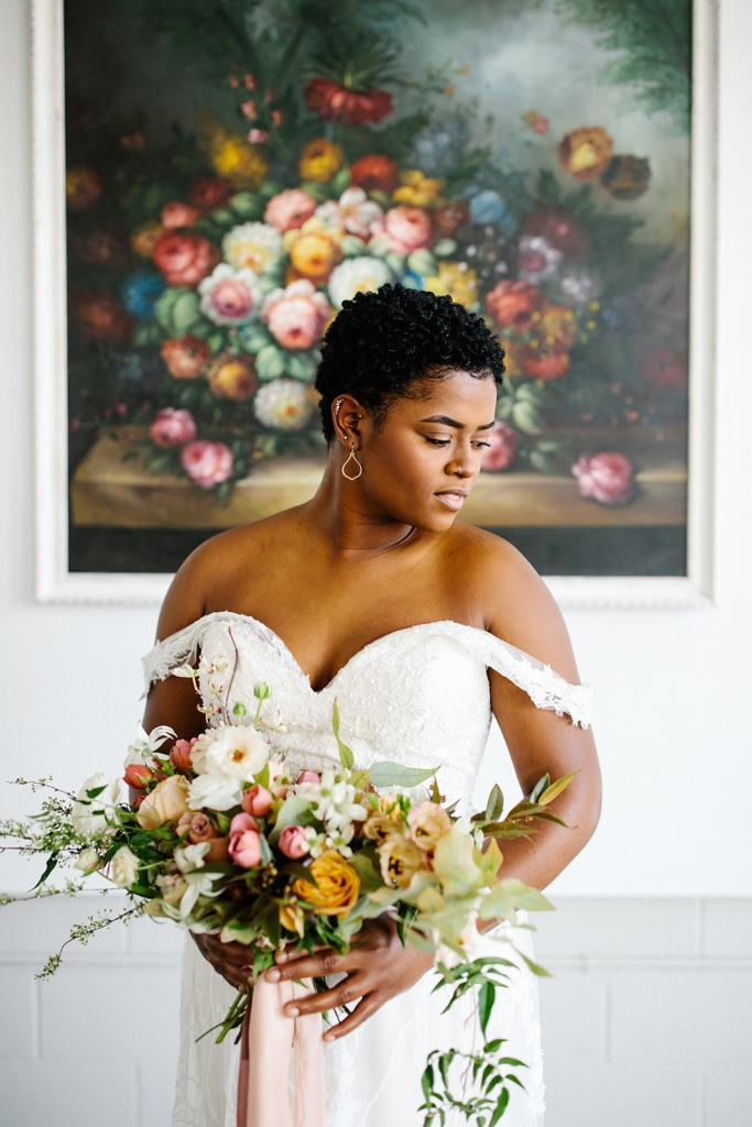 Editorial inspired by vintage painting with African American model. Flowers and design by Jessica Ormond Events. Photography by Greenhouse Creative.