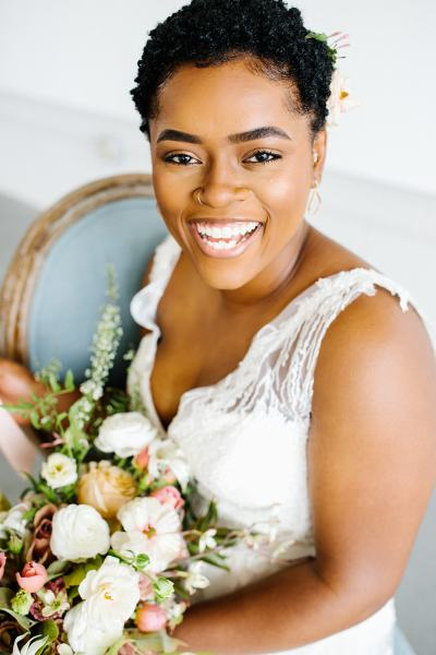 Beaming bride with spring flowers for Vintage inspired editorial. Image by Greenhouse Creative. Design by Jessica Ormond Events.