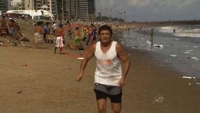 Photo of TV flagra mulher sendo agredida em praia durante gravação de reportagem