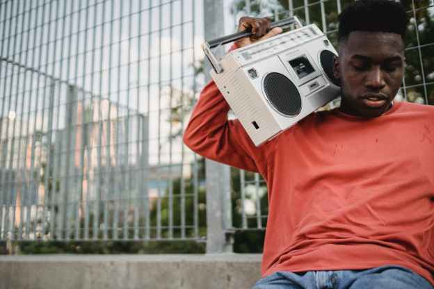 black man with boombox in park