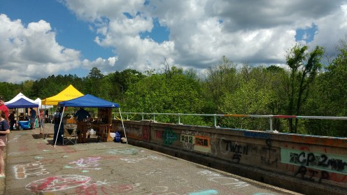 Strange graffiti from the town's high school grads provided atypical backdrop for an arts fair.