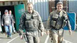 David Hewlett and Kavan Smith take a break from the dust and debris.