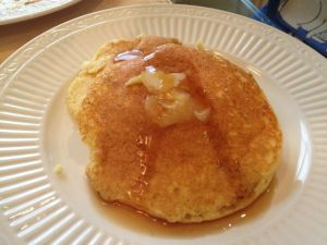 Ricotta pancakes with honey-butter and maple syrup